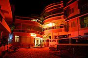 luxury hotel resort at night, kerala, india