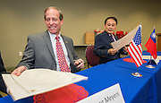 Houston ISD trustee Greg Meyers, left, and  Director General Louis M. Huang, right, of the Taipei Economic and Cultural Office in Houston, sign a partnership agreement ceremony, December 17, 2015.