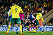 Norwich City midfielder James Maddison (23) makes a tackle Sheffield Wednesday forward Jordan Rhodes (7)   during the EFL Sky Bet Championship match between Norwich City and Sheffield Wednesday at Carrow Road, Norwich, England on 9 December 2017. Photo by Phil Chaplin.