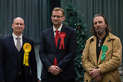 Maidenhead, UK. 13 December, 2019. Julian Tisi (l, Liberal Democrat), Peter Shearman (c, Labour) and Fintan McKeown (r, Green) await the general election results for the Windsor constituency.