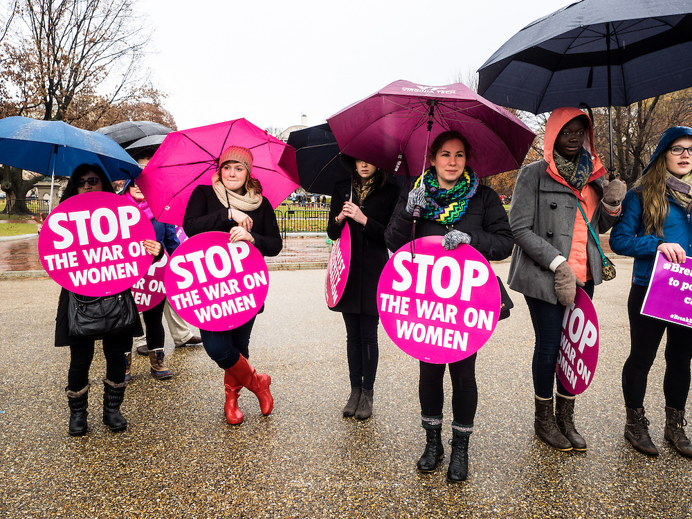 Participants carry signs at a rally calling on president Obama to ensure the United States is a leader in providing comprehensive, post-rape care, including safe abortion services, to survivors of sexual violence in front of the White House in Washington, DC<br /> <br /> PHOTOS/John Nelson