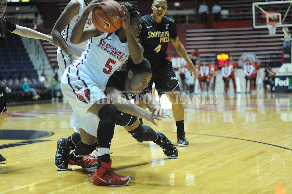 "Ole Miss Lady Rebels guard Erika Sisk (5) goes for a loose ball against Southern Mississippi Lady Golden Eagles guard Megan Brown (22) at the C.M. ""Tad"" Smith Coliseum in Oxford, Miss. on Thursday, December 18, 2014. (AP Photo/Oxford Eagle, Bruce Newman)"