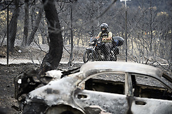 July 25, 2018 - Mati, Greece - Burned-out cars ..Aftermath of deadly wildfires, Mati, Greece, 2018-07-25..(c) MORALES FELIPE  / Aftonbladet / IBL BildbyrÃ¥....* * * EXPRESSEN OUT * * *....AFTONBLADET / 85492 (Credit Image: © Morales Felipe/Aftonbladet/IBL via ZUMA Wire)