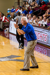 Kentucky Boys All-Stars coach Wayne Breeden cheers on his squad in the second half. The Kentucky vs. Indiana All-Star Classic was held, Sunday, June 12, 2016 at Bellarmine University's Knights Hall in Louisville.
