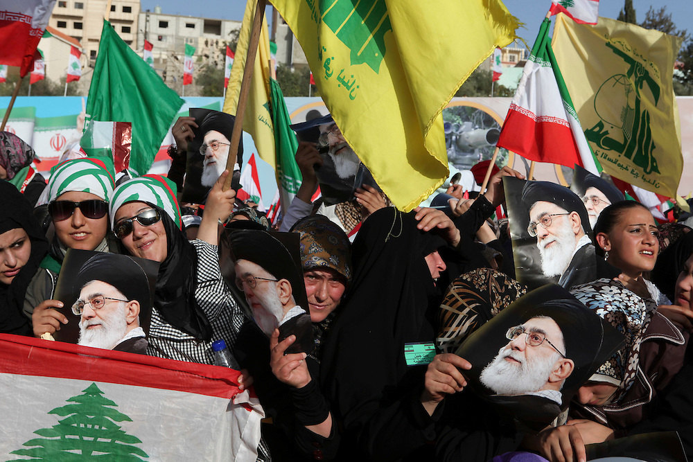 On the second and final day of his visit to Lebanon, Iranian President Mahmoud Ahmadinejad traveled to the southern town of Bint Jbeil. There a Hizballah-organized rally was held to welcome Ahmadinejad to the south Lebanon, an area where Hizballah is widely supported. Tens of thousands gathered for hours holding flags of Iran, Hizballah, Lebanon and other political parties, cheering the Iranian president as he arrived by helicopter from Beirut. ///People rally at a stadium in Bint Jbeil waiting for Iranian President Mahmoud Ahmadinejad to address the crowd.