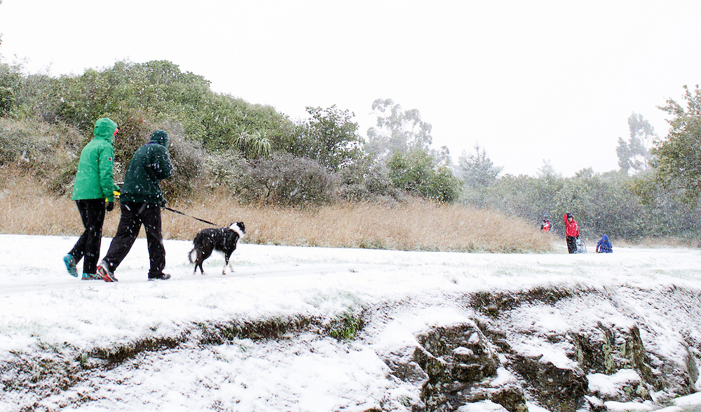 Walkers brave the first season's snowfall on the Port Hills, Christchurch, New Zealand, Tuesday, April 14, 2015. Credit:SNPA / Sam Hoeflich