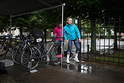 Riders dodge puddles in the heavy rain before the start of the 76,1 km first stage of the 2016 Ladies' Tour of Norway women's road cycling race on August 12, 2016 between Halden and Fredrikstad, Norway. (Photo by Balint Hamvas/Velofocus)
