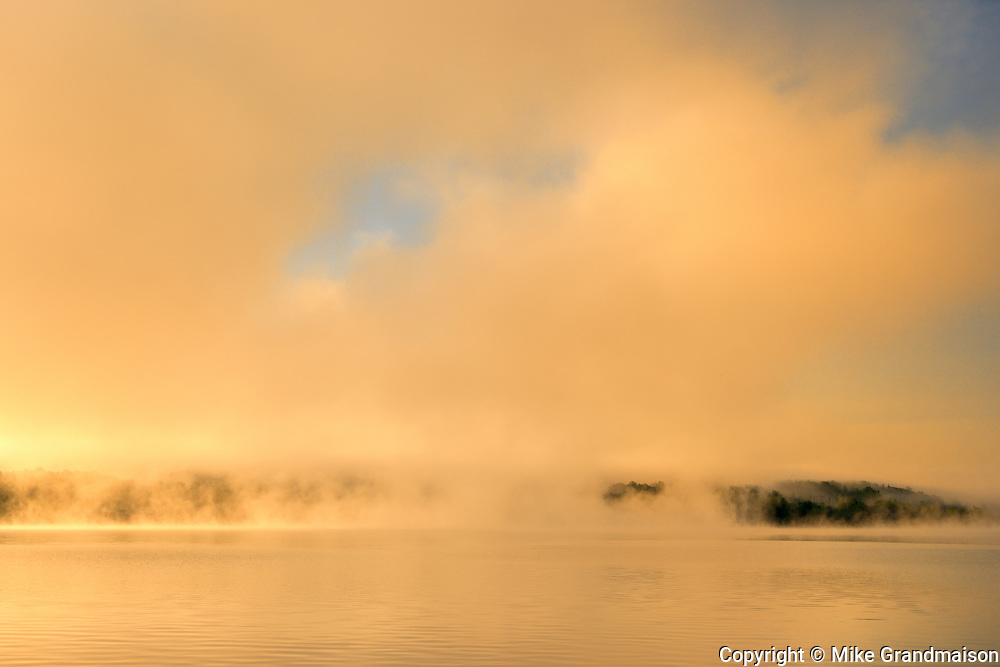 Morning fog on the Saint John River at sunrise<br /> <br /> New Brunswick<br /> Canada