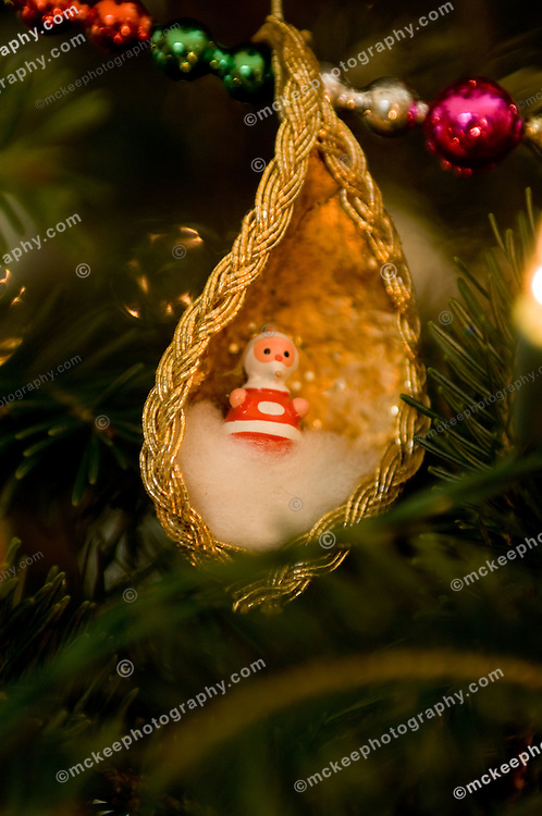Antique santa ornament on a christmas tree