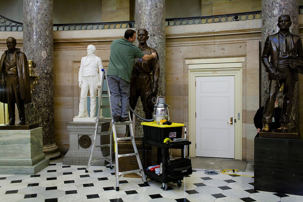 A worker cleans statues in the U.S. Capitol on January 19, 2011 in Washington, DC.