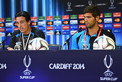 CARDIFF, WALES - Tuesday, August 12, 2014: Sevilla's head coach Unai Emery and Federico Fazio during a press conference ahead of the UEFA Super Cup at Cardiff City Stadium.  (Pic by Pool/Getty Images/Propaganda)