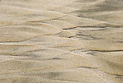 Tides have shaped sea sand into scalloped abstract patterns at Seaside, on the Oregon coast, USA