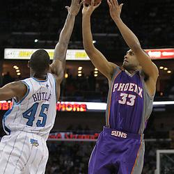 03 December 2008:  Phoenix Suns forward Grant Hill (33) shoots over New Orleans Hornets guard Rasual Butler (45) during the first half of a NBA regular season game between the Phoenix Suns and the New Orleans Hornets at the New Orleans Arena in New Orleans, LA..