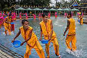 Residents and staff at the Olive Dam Dai cultural village take part in a daily water festival, Xishuangbanna, China. The Dai are an ethnic minority living in western China as well as northern Laos, Thailand, and Vietnam.