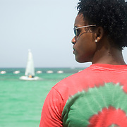 Dominican man looking out over the Caribbean