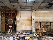 26 FEBRUARY 2016 - BANGKOK, THAILAND: Inside an abandoned shophouse in the Verng Nakorn Kasem neighborhood. Verng Nakorn Kasem, also known as the Thieves' Market, was one of Bangkok's most famous shopping districts. It is located on the north edge of Bangkok's Chinatown district, it grew into Bangkok's district for buying and selling musical instruments. The family that owned the land recently sold it and the new owners want to redevelop the famous area and turn it into a shopping mall. The new owners have started evicting existing lease holders and many of the shops have closed. The remaining shops expect to be evicted by the end of 2016.      PHOTO BY JACK KURTZ