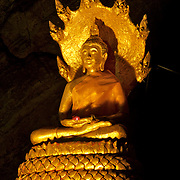 Buddha and Naga at Khao Luang Cave This picturesque cave, some 5 kilometers from Khao Wang, in Phetachaburi province, contains a Buddha image cast by the royal command of King Chulalongkorn to honour his father, King Mongkut.