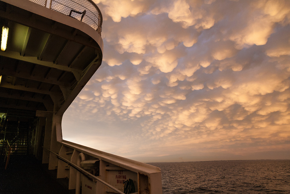 stormy skies over Long Island Sound threaten deck on the Port Jefferson to Bridgeport ferry
