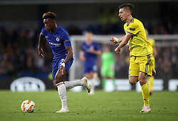 Chelsea's Callum Hudson-Odoi and BATE Borisov's Aleksey Rios (right) battle for the ball during the UEFA Europa League, Group L match at Stamford Bridge, London.