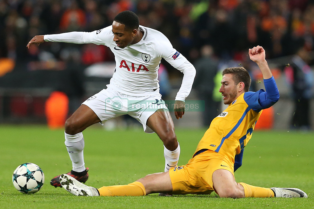 6 December 2017 - Champions League Football - Tottenham Hotsur v APOEL FC - Minas Antoniou of Apoel Nicosia stretches to tackle Kyle Walker-Peters of Tottenham - Photo: Charlotte Wilson / Offside