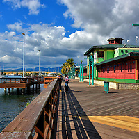La Guancha Boardwalk in Ponce, Puerto Rico<br /> At the southern tip of the Municipality of Ponce is the La Guancha Boardwalk. Since opening in 1998, the Paseo Tablado La Guancha has been a popular attraction for local families. It features food, watercraft rides, paddle board and kayak rentals, concerts in the pavilion, a playground plus great views of the marina along the Caribbean Sea. Kids especially enjoy feeding fish to the tarpons and pelicans. Nearby is the Ponce Beach.