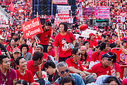 30 NOVEMBER 2013 - BANGKOK, THAILAND:  Pro-government Red Shirts rally in Bangkok Saturday. Political faultlines in Bangkok, the Thai capital, hardened Saturday. Antigovernment factions repeated promises to strike at the heart of Bangkok Sunday and bring down the government while thousands of Red Shirts, who support the government, have come to Bangkok from their base in rural Thailand to defend the government. Prime Minister Yingluck Shinawatra has appealed for calm, but her opponents have rejected all requests for negotiations saying the only acceptable outcome is the eradication of the government.       PHOTO BY JACK KURTZ