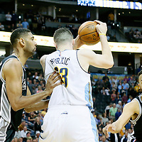 08 April 2016: San Antonio Spurs center Tim Duncan (21) defends on Denver Nuggets center Jusuf Nurkic (23) next to San Antonio Spurs forward Kyle Anderson (1) during the Denver Nuggets 102-98 victory over the San Antonio Spurs, at the Pepsi Center, Denver, Colorado, USA.
