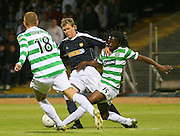 Dundee v Celtic - CIS Insurance League Cup - 3rd Round - Dens Park, Dundee<br /> 26/09/07<br /> Dundee's Kevin McDonald takes on the twin challenge of Celtic's Evander Sno and Massimo Donati