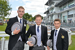 Left to right, England cricketers STUART BROAD, EOIN MORGAN and JAMES TAYLOR at the Investec Derby 2015 at Epsom Racecourse, Epsom, Surrey on 6th June 2015.