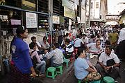 A busy street cafe next to the Bogyoke market in central Yangon, Myanmar (Burma).