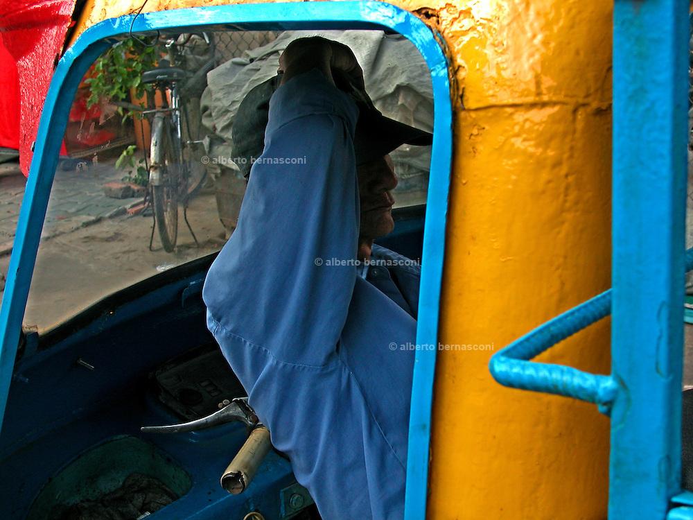 Vietnam, Ho Chi Min City: resting in the apecar.