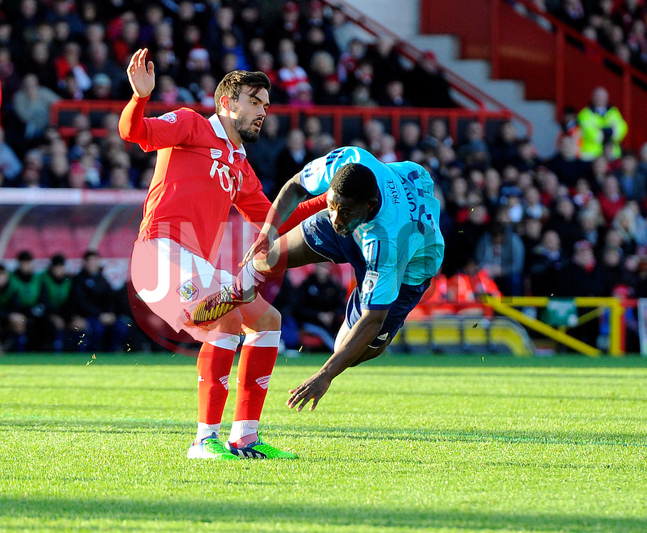 Bristol City's Marlon Pack battles for the ball with AFC Telford's Godfrey Poku  - Photo mandatory by-line: Joe Meredith/JMP - Mobile: 07966 386802 - 07/12/2014 - SPORT - Football - Bristol - Ashton Gate - Bristol City v AFC Telford United - FA Cup
