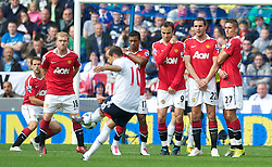 BOLTON, ENGLAND - Sunday, September 26, 2010: Bolton Wanderers' Martin Petrov takes a free-kick against Manchester United during the Premiership match at the Reebok Stadium. (Photo by David Rawcliffe/Propaganda)
