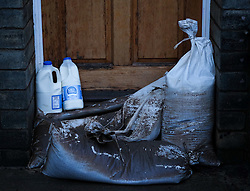 © Licensed to London News Pictures. 29/12/15<br /> York, UK. <br /> <br /> Freshly delivered milk stands on sandbags in doorways as flood water begins to subside on Huntington Road in York. Further rainfall is expected over coming days as Storm Frank approaches the east coast of the country.<br /> <br /> <br /> Photo credit : Ian Forsyth/LNP