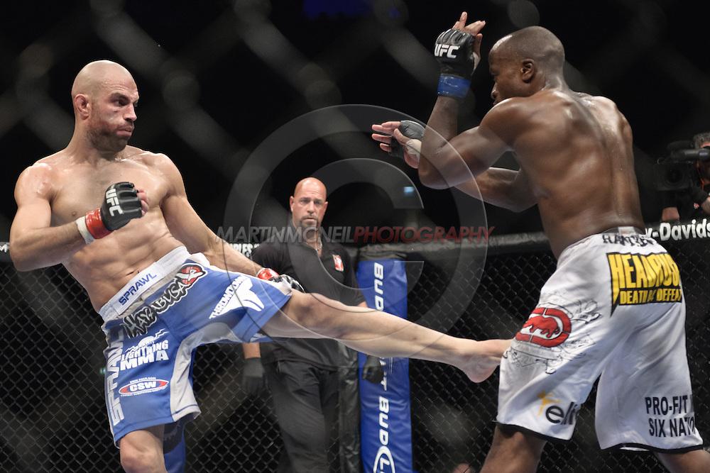 "LONDON, ENGLAND, OCTOBER 2010: James Wilks (left) kicks towards the legs of Claude Patrick during ""UFC 120: Bisping vs. Akiyama"" inside the O2 Arena in Greenwich, London"