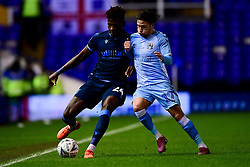 Rollin Menayese of Bristol Rovers is marked by Callum O'Hare of Coventry City - Mandatory by-line: Ryan Hiscott/JMP - 14/01/2020 - FOOTBALL - St Andrews Stadium - Coventry, England - Coventry City v Bristol Rovers - Emirates FA Cup third round replay