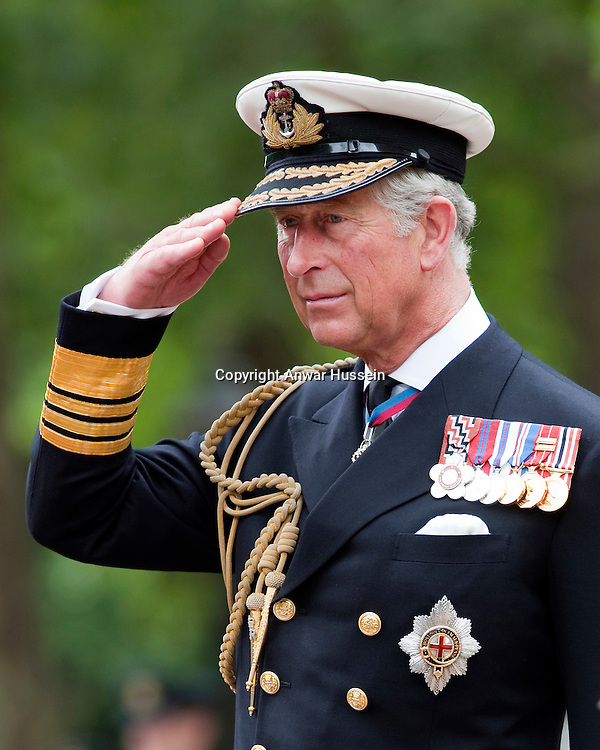 Prince Charles, Prince of Wales takes the salute on the Mall in London during a march-past and review by members of the Cadet Force celebrating their 150th anniversary on July 6, 2010..