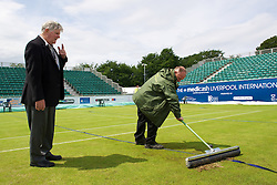 LIVERPOOL, ENGLAND - Saturday, June 23, 2012: Tournament Referee Alan Mills looks on as groundstaff prepare centre court for the Men's Final during day three of the Medicash Liverpool International Tennis Tournament at Calderstones Park. (Pic by David Rawcliffe/Propaganda)