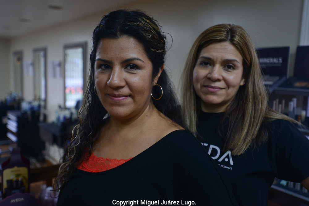 PAINESVILLE, OH - OCT. 15, 2012.  Sisters Angela and María Soto in the hair salon they own in this suburban Cleveland town.  Their family includes ten brothers, 8 of whom are now US citizens. The other two are in the process. Their father, Felix Soto, is considered the first Mexican immigrant to settle in  this Lake Erie region in the early 1970's. The Soto sisters vote Democrat. Angela said she believes Obama needs more time to fix the economy. (Photo by Miguel Juárez Lugo)