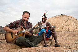 """Dave Matthews (@davematthewsband) plays his song """"Mother of Africa"""" with his friend, Robert Lemaian, at Reteti Elephant Sanctuary (@r.e.s.c.u.e) in northern Kenya. I met Dave in the middle of a blizzard at Standing Rock in North Dakota last year and by some small miracle, he agreed to come to the elephant sanctuary and allow me make a short film. It will launch next week and screen at his 47 concerts. Dave has tirelessly worked as an advocate for conservation efforts and contributed large sums to peacefully proactive environmentalist groups. Go see him if you can. Not only is his music beautiful but he is an authentically awesome human being. <br /> <br /> Reteti Elephant Sanctuary, in northern Kenya is the first ever community-owned and run elephant sanctuary in Africa. The sanctuary provides a safe place for injured elephants to heal and later, be returned back to the wild.  You can support this incredible place and the people who protect wildlife. Buy a raffle ticket for only $10 to support Reteti.You could win a trip to Kenya, see Dave Matthews in concert and take home Dave's handmade guitar with @prizeo (Link in profile). Not only will you be helping care for orphaned baby elephants and strengthening community ties, you'll also have a chance to win a life-changing trip to see the sanctuary in person. The first $10,000 in funds raised will be generously matched by Elephant Gems (@elephantgems).<br /> <br /> Reteti operates in partnership with Conservation International (@conservationorg) who provide critical operational support and work to scale the Reteti community-centered model to create lasting impacts worldwide. <br /> <br /> Photo by @amivitale."""