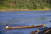 Machiguenga Indians in Canoe<br />Timpia Community, Lower Urubamba River<br />Amazon Rain Forest, PERU.  South America