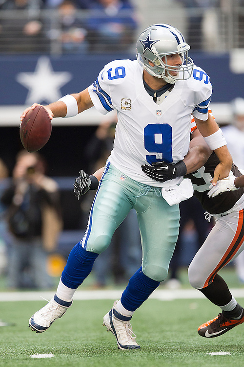ARLINGTON, TX - NOVEMBER 18:  Tony Romo #9 of the Dallas Cowboys is wrapped up by Craig Robertson #53 of the Cleveland Browns at Cowboys Stadium on November 18, 2012 in Arlington, Texas.  The Cowboys defeated the Browns 23-20.  (Photo by Wesley Hitt/Getty Images) *** Local Caption *** Tony Romo;  Craig Robertston