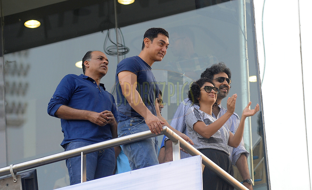 Bollywood personalities Aamir Khan, Ashutosh Gowarikar during day two of the second Star Sports test match between India and The West Indies held at The Wankhede Stadium in Mumbai, India on the 15th November 2013<br /> <br /> This test match is the 200th test match for Sachin Tendulkar and his last for India.  After a career spanning more than 24yrs Sachin is retiring from cricket and this test match is his last appearance on the field of play.<br /> <br /> <br /> Photo by: Pal PIllai - BCCI - SPORTZPICS<br /> <br /> Use of this image is subject to the terms and conditions as outlined by the BCCI. These terms can be found by following this link:<br /> <br /> http://sportzpics.photoshelter.com/gallery/BCCI-Image-Terms/G0000ahUVIIEBQ84/C0000whs75.ajndY