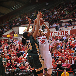 Jan 31, 2009; Piscataway, NJ, USA; Rutgers guard Brittany Ray (35) puts up a shot against South Florida center Jessica Lawson (23) during the closing minutes of South Florida's 59-56 victory over Rutgers in NCAA women's college basketball at the Louis Brown Athletic Center