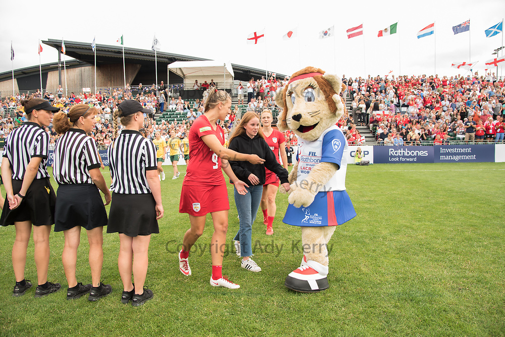 Laura Merrifield, England Captain, leads the team out against Australia accompanied by Hannah Townend, winner of the competition to design the mascot for the 2017 FIL Rathbones Women's Lacrosse World Cup at Surrey Sports Park, Guilford, Surrey, UK, 15th July 2017