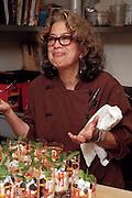 Susan Feniger tasting in the kitchen