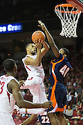 FAYETTEVILLE, AR - DECEMBER 19:  Rickey Scott Jr. #3of the Arkansas Razorbacks goes up for a shot while being defended by Jayler Martinez #40 of the UT Martin Skyhawks at Bud Walton Arena on December 19, 2013 in Fayetteville, Arkansas.  The Razorbacks defeated the Skyhawks 102-56.  (Photo by Wesley Hitt/Getty Images) *** Local Caption *** Rickey Scott Jr.; Jaylor Martinez