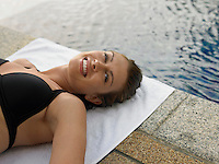 Young Woman in Bikini by Swimming Pool