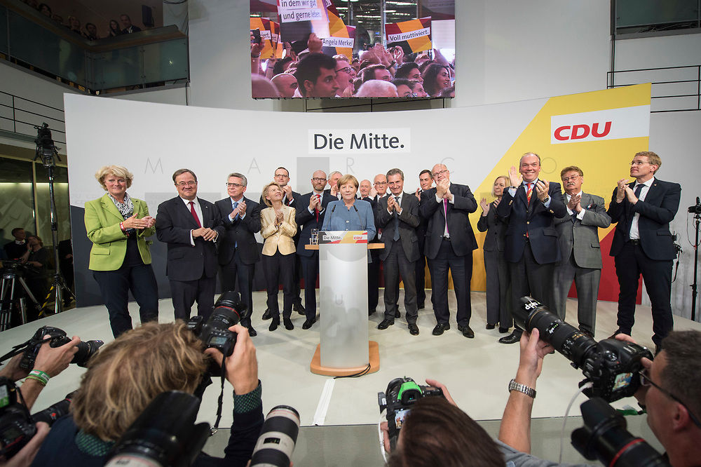 24 SEP 2017, BERLIN/GERMANY:<br /> Angela Merkel (M), CDU, Bundeskanzlerin, eingerahmt von Monika Gruetters, Armin Laschet, Thomas de Maiziere, Ursula von der Leyen, Jens Spahn, Peter Tauber, Karl-Josef Laumann, Dr. Klaus Schueler, Volker Kauder, Guenther Oettinger, David McAllister, Peter Altmeier, Johanna Wanka, Philipp Murmann, Elmar Brok, Daniel Guenther, (v.L.n.R.), Wahlparty in der Wahlnacht, Bundestagswahl 2017, Konrad-Adenauer-Haus, CDU Bundesgeschaeftsstelle<br /> IMAGE: 20170924-01-034<br /> KEYWORDS: Election Party, Election Night