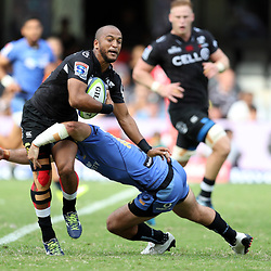 Rhyno Smith of the Cell C Sharks tackled by Jono Lance of Western Force during the Super Rugby match between the Cell C Sharks and the Western Force at Growthpoint Kings Park on May 06, 2017 in Durban, South Africa. (Photo by Steve Haag)